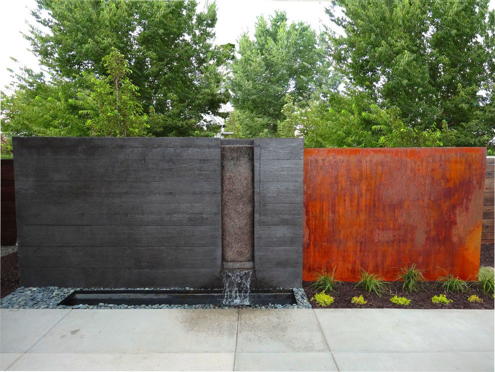 Mile High Ministries with Modern Landscape Also Arbor Contemporary Design Custom Water Feature Denver Landscape Metal Arbor Modern Landscape Recessed Water Feature Rust Orange Rust Red Rusted Wall Sloans Lake Small Plants Stones Water Feature