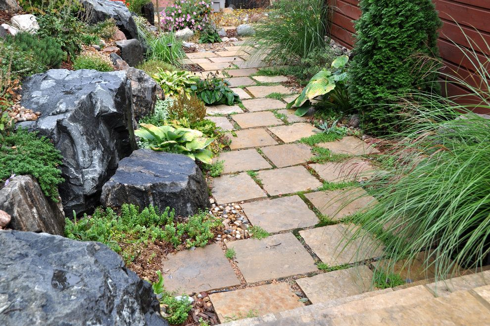 Mile High Ministries with Traditional Landscape  and Boulders Flowers Grasses Ground Cover Path Stepping Stones Stones Walkway Wood Fence