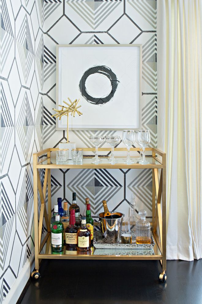 Monogrammed Whiskey Decanter   Contemporary Home Bar  and Drinks Cabinet Framed Artwork Gilded Bar Cart Gold Accents Gray Geometric Wallpaper Ivory Curtains Wine Glasses