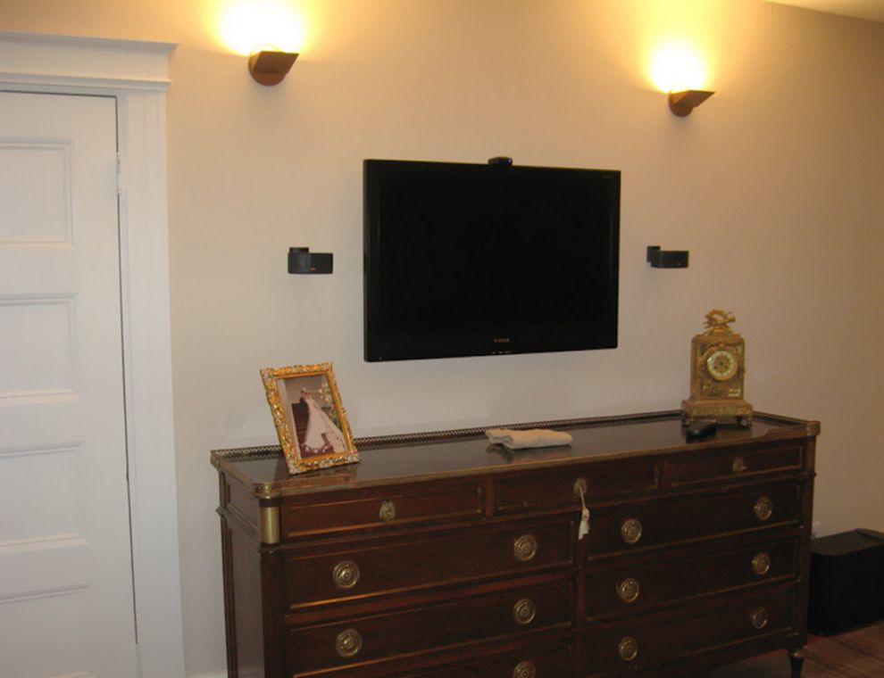 Natick Theater   Traditional Bedroom Also Beige Walls Boston Home Media Home Theater Natick Home Media Sconce Lighting Tv Mounted on Wall Wood Dresser