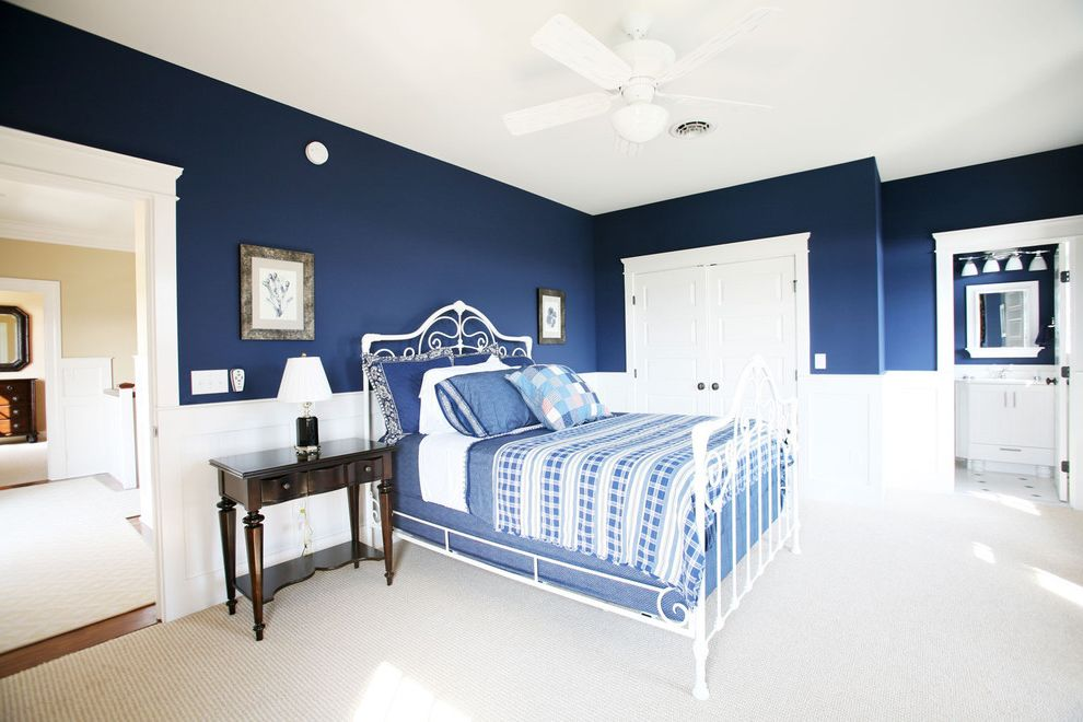 Navy Blue Bed Sheets   Traditional Bedroom Also Bedside Table Blue Bedding Blue Bedroom Blue Walls Ceiling Fan Ceiling Lighting Closet Dark Walls Iron Bed Nightstand Wainscoting Wall Art Wall Decor White Wood Wood Trim