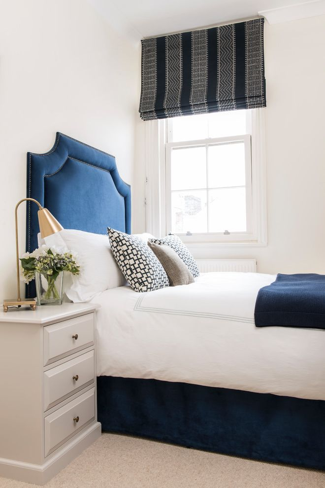 Navy Blue Bed Sheets with Transitional Bedroom  and Bed Cushions Blue and White Blue Bed Frame Blue Headboard Blue Velvet Headboard Cream Bedside Table Geometric Blinds Gold Table Lamp Striped Roman Blinds Velvet Headbaord White Walls