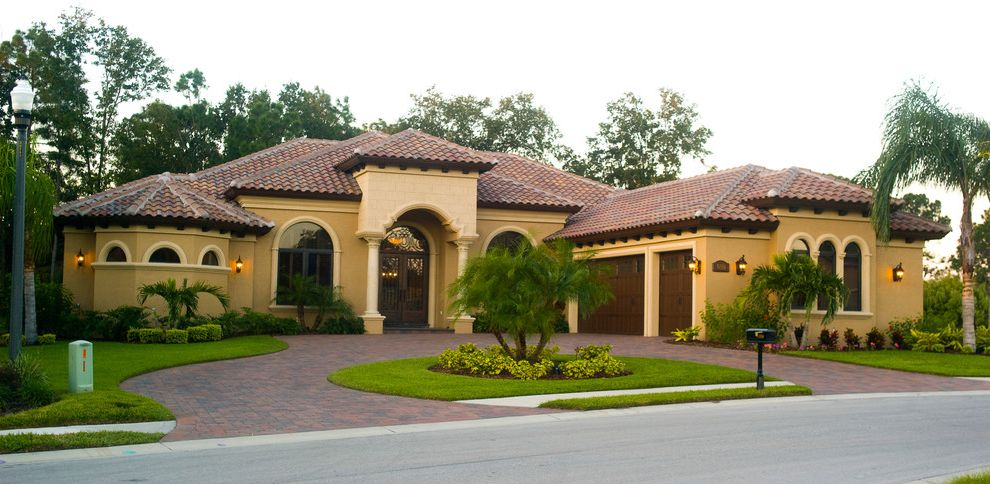 Olivera Construction   Mediterranean Exterior  and Arches Brackets Cantera Door Circular Driveway Coach Lights Custom Home Exterior Exterior Elevations Front Elevation Mediterranean Pavers Tile Roof