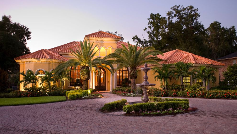 Olivera Construction with Mediterranean Exterior Also Bronze Windows Cantera Door Circular Driveway Custom Home Exterior Elevation Front Elevation Mediterranean Palm Trees Pavers Tile Roof