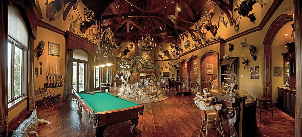 Olivera Construction with  Spaces  and African Theme Animals Exposed Wood Beams Stained Room Trophy Room Wood Ceiling