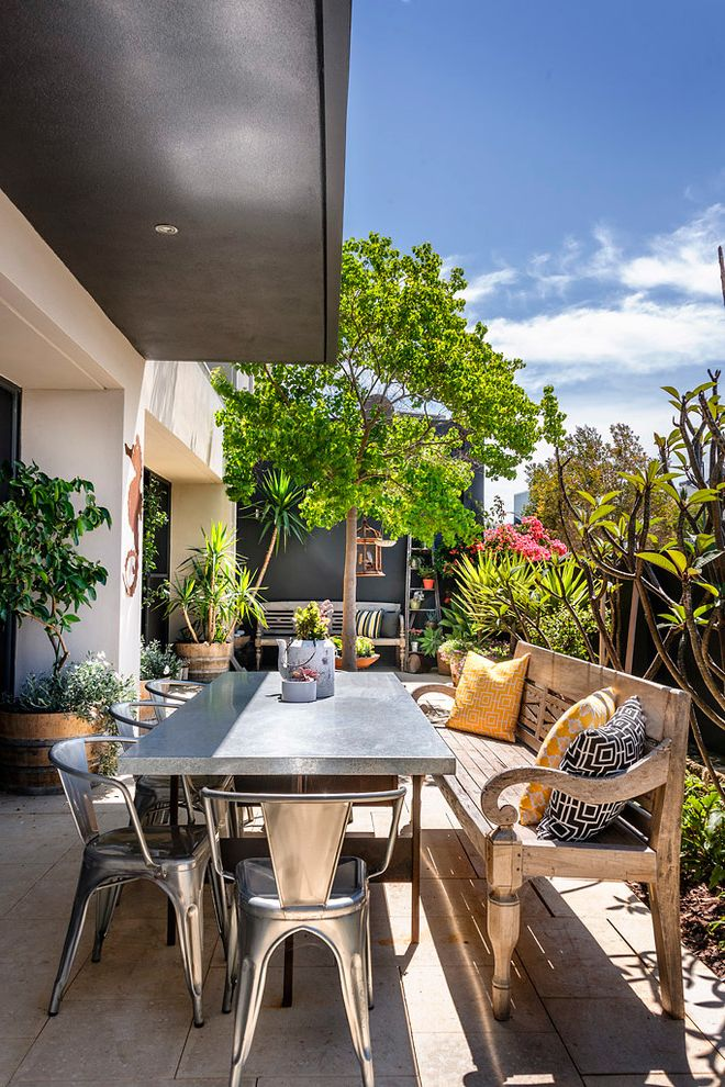 Outdoor Console Table Metal with Contemporary Patio  and Bushes Concrete Patio Metal Chair Metal Outdoor Table Metal Side Chair Metal Table Outdoor Potted Plants Roof Overhang Shrubs Trees Wood Dining Bench Wood Outdoor Bench