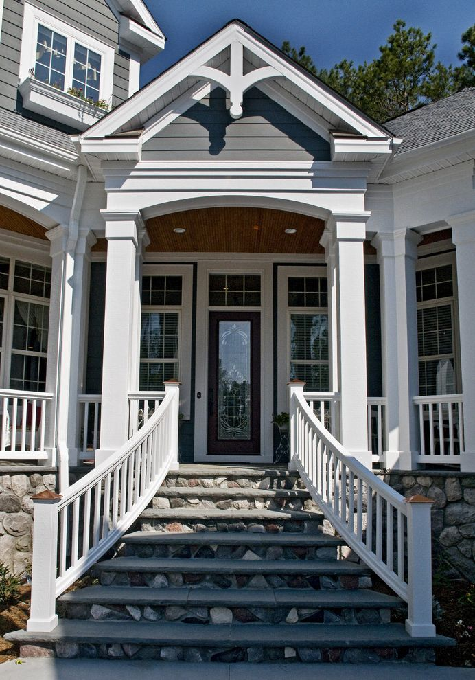 Outside Step Railings with Traditional Entry  and Dormer Windows Front Door Handrail Porch Stairs Steps Stone Wall Transom White Wood Wood Columns Wood Railing Wood Siding Wood Trim