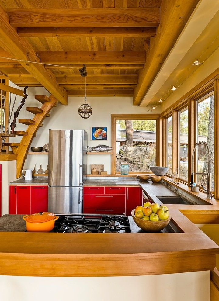 Oxbow Window   Rustic Kitchen Also Cable Lighting Concrete Countertop Gray Countertop Leibherr Fridge Pendant Light Red Cabinets Soffit Wood Beams Wood Ceiling