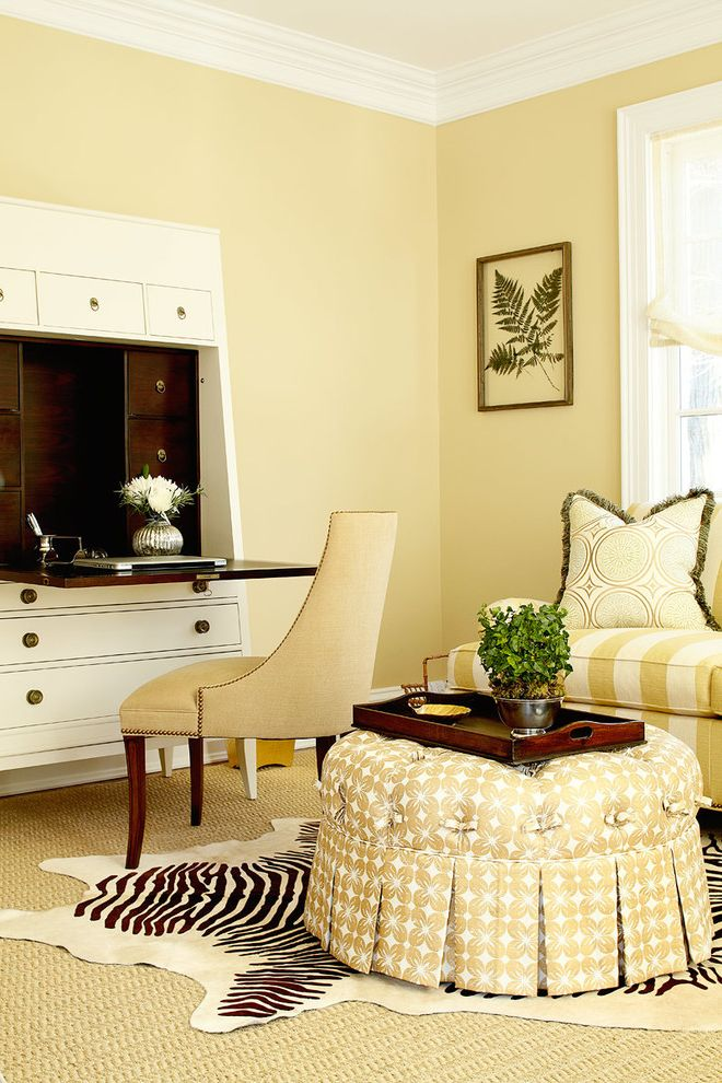 Oxbow Window with Transitional Living Room Also Beige Sofa Botanical Gold Accents Round Cocktail Ottoman Secretary Desk Sisal Rug White Desk White Living Room White Room White Sofa White Window Trim Wood Flooring Zebra Rug