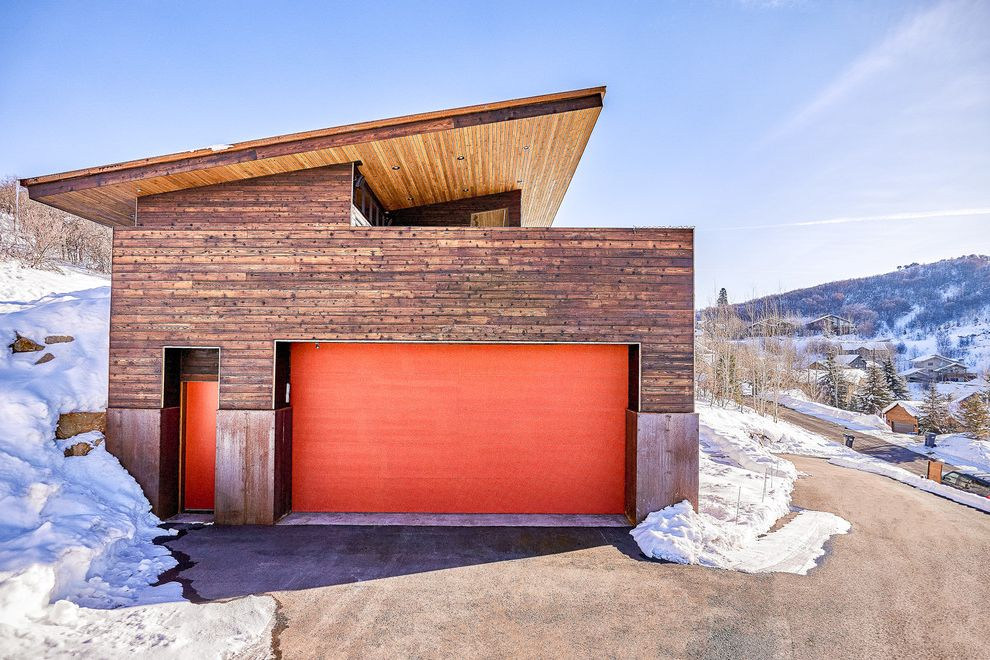 Park City Showcase of Homes   Contemporary Garage  and Contemporary Rustic Modern Cabin Mountain Modern Orange Garage Door Park City Pop of Color Shed Roof