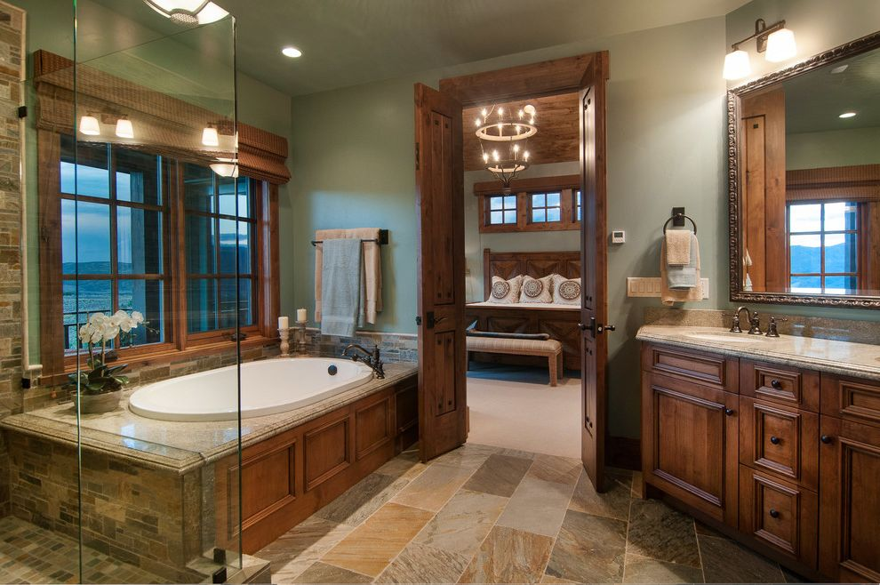 Park City Showcase of Homes with Rustic Bathroom  and Double Doors en Suite Frameless Glass Shower Granite Countertop Granite Tub Surround Master Bathroom Master Suite Mirror Lighting Ornate Mirror Frame Silver Mirror Frame Slate Floor Tile Floor