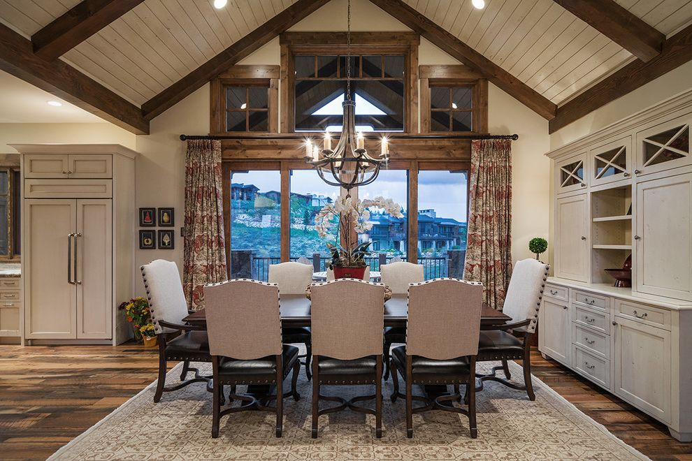 Park City Showcase of Homes with Rustic Dining Room  and Cathedral Ceiling Clerestory Windows Dark Wood Beams Dark Wood Trim Gray Area Rug High Ceiling Mountain Home Vaulted Ceiling