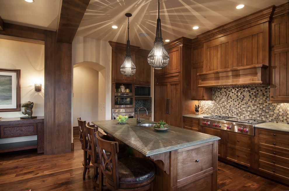 Park City Showcase of Homes with Rustic Kitchen Also Arch Dark Hardwood Floor Dark Wood Floor Gas Rangetop Green Counter Island Pendant Lights Multi Color Backsplash Recessed Lighting Shadows