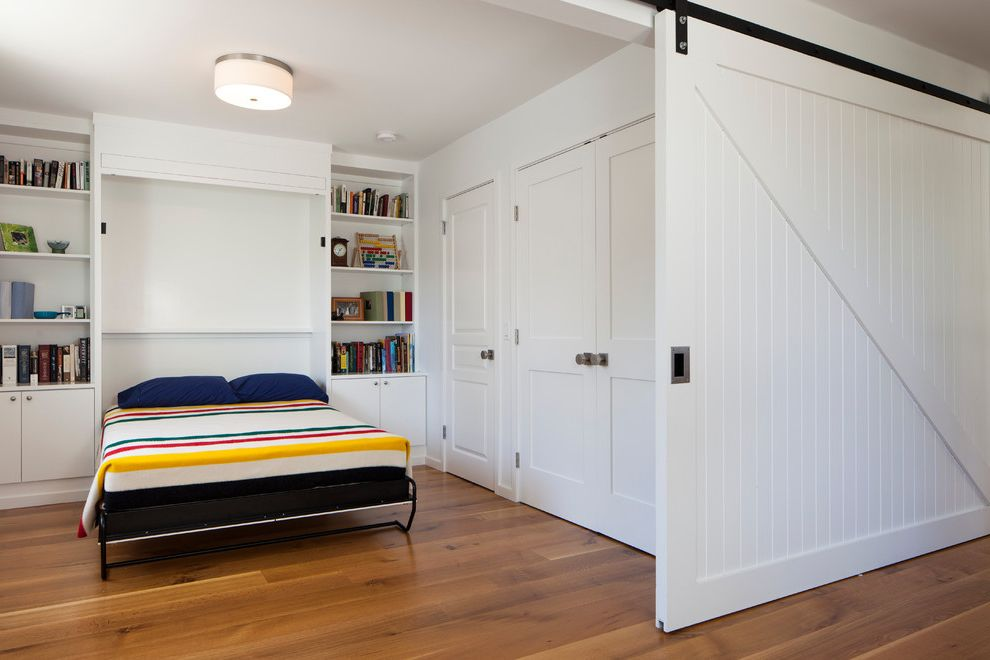 Petaluma Storage with Contemporary Bedroom Also Barn Door Beadboard Books Bookshelves Built Ins Ceiling Light Modern Farmhouse Murphy Bed Sliding Door Striped Blanket Track Door White