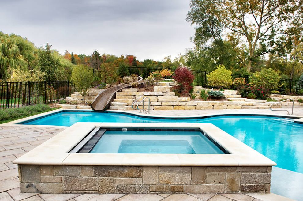 Platinum Pools Az with Traditional Pool  and Custom Pool Custom Pool and Spa Custom Spa Landscape Patio Patio Pavers Planting Slide Spa Stone Stone Pool Stone Spa