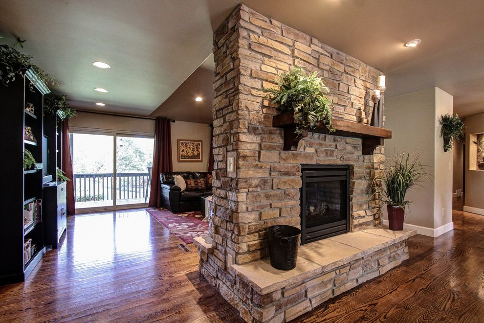 Plumber Parker Co   Traditional Family Room Also Capstone Home Renovations Double Sided Gas Fireplace Hardwood Floors Parker Granite Countertops Parker Kitchen Remodel Parker Kitchen Remodel Contractor Pinery Kitchen Remodel Stone Fireplace