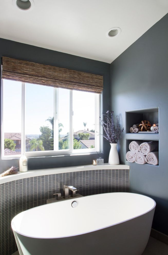Plumber Vista Ca   Contemporary Bathroom  and Accent Wall Lotion Recessed Shelving Slanted Ceiling Sliding Window Straw Roman Shades White Vase