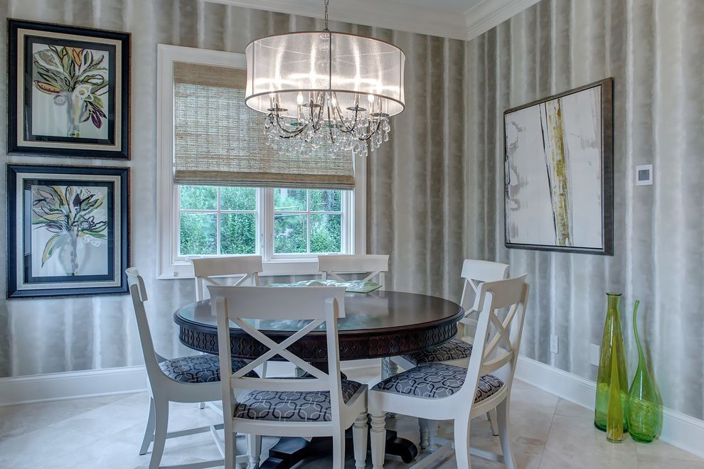 Rectangular Drum Shade Chandelier with Transitional Dining Room Also Artwork Baseboard Blue Seat Cushions Chandelier Crown Molding Green Glass Vases Round Dining Table Tile Floor Wallpaper White Casing White Dining Chairs Woven Wood Blinds