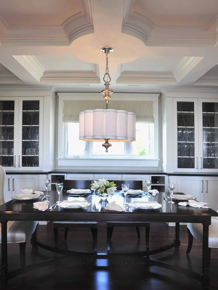 Rectangular Drum Shade Chandelier with Transitional Dining Room Also Coffered Ceiling Dark Stained Floors Dining Area Drum Shade Formal Glass Front Cabinets Pendant Lamp Place Settings Roman Shade Upholstered Dining Chairs