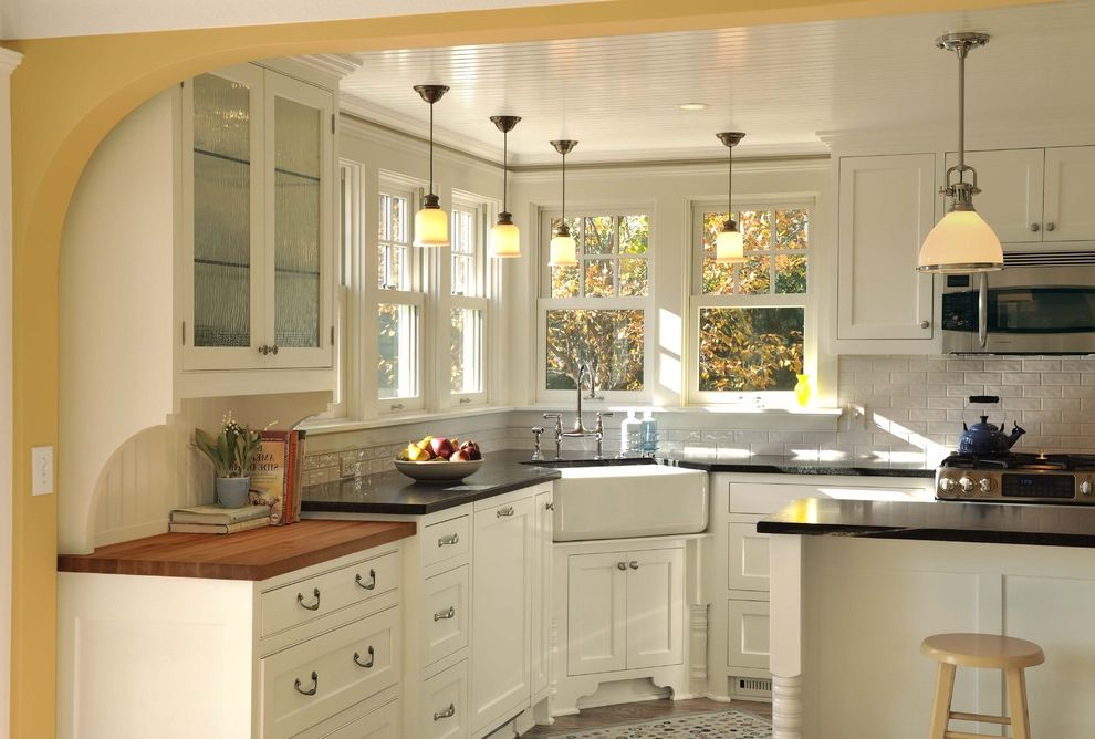 Refinish Kitchen Sink   Traditional Kitchen  and Apron Sink Butcher Block Corner Sink Counter Stools Farm Sink Frame and Panel Island Pendant Lights Subway Tile Tile Floor White Painted Wood Yellow