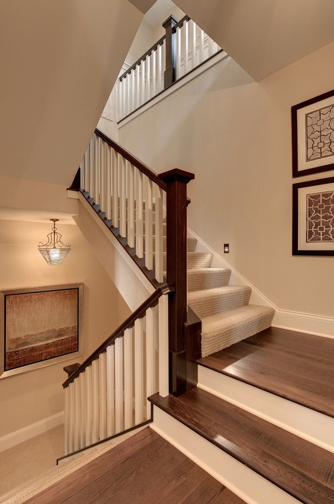 Replacing Carpet on Stairs with Traditional Staircase  and Beige Painted Wall Carpet Runner Carpeting Dark Brown Handrail Earth Tones Framed Art Landing Neutral Colors Pendant Steps White Banister White Baseboard White Risers Wood Staircase