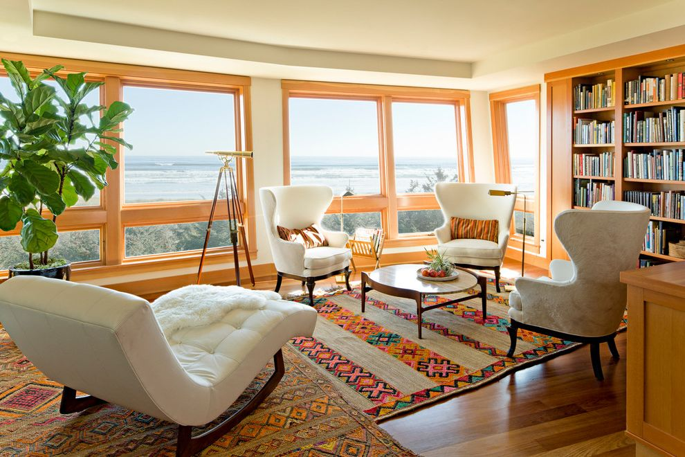 Reupholster Recliner   Contemporary Living Room  and Beach House Beach Views Bright Color Built in Shelves Chaise Longue Coast Colorful Rugs Cowhide Large Windows Library Linen Living Room Moroccan White Upholstered Furniture Wingback Wood Trim