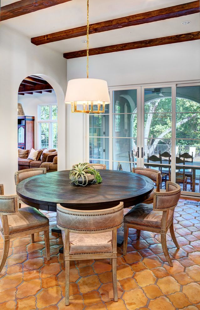 Round Comfy Chair with Mediterranean Dining Room  and Exposed Beams Highland Park Nailhead Detail Pedestal Table Texas Wood Beams