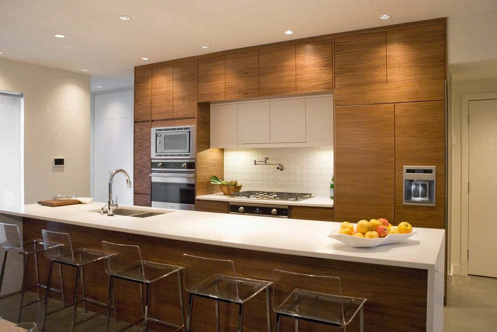 Ruvati Sinks with Contemporary Kitchen Also Bar Stools Eat in Flat Panel Cabinets Floor to Ceiling Cabinets Integrated Fridge Island Khaki Painted Wall Neutral Colors Recessed Lights Stainless Steel Appliances White Backsplash Wood Cabinets