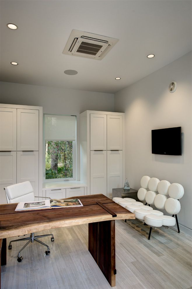 Ryland Homes Orlando   Contemporary Home Office Also Built in Cabinets Dark Wood Desk Gray Wall Light Wood Floor Painted Ceiling Rolling Desk Chair Rustic Wood Desk Wall Mounted Tv White Desk Chair White Sofa