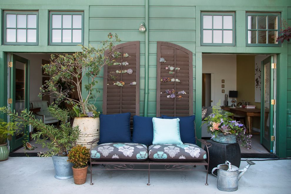 San Benito Shutters with Eclectic Patio Also Bench Charming Glass Doors Green House Outdoor Pillows Potted Plants Shutters Watering Cans