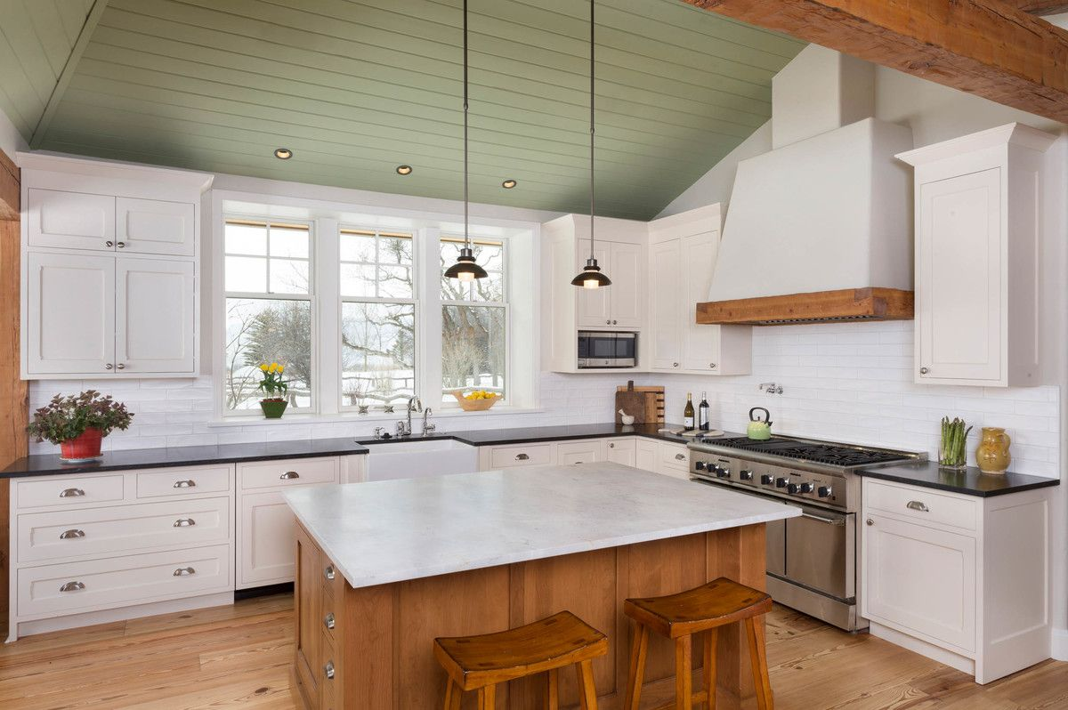 Sanding and Staining Wood Floors   Farmhouse Kitchen  and Cup Pulls Custom Vent Hood Green Panel Ceiling Mini Pendant Light Row of Windows Vaulted Ceilings White Kitchen Windows Over Sink Wood Counter Stool Wood Kitchen Island