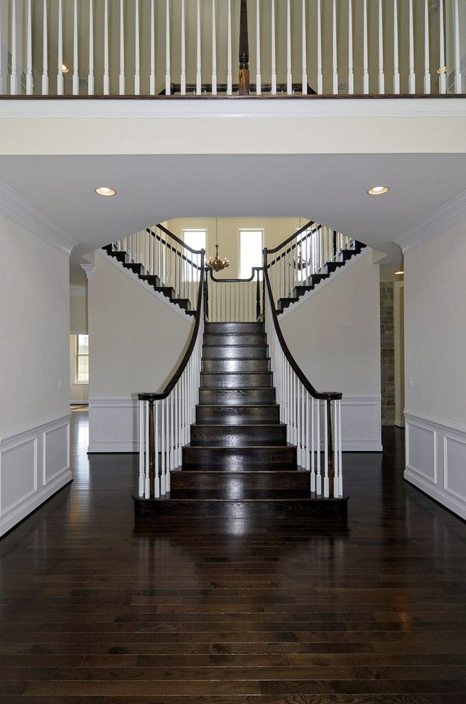 Sanding and Staining Wood Floors   Traditional Staircase Also Butterfly Stair Case Chandelier Dark Wood Dark Wood Stairs T Staircase Wainscoting White and Wood Wood Floor Wood Railing Wood Stairs