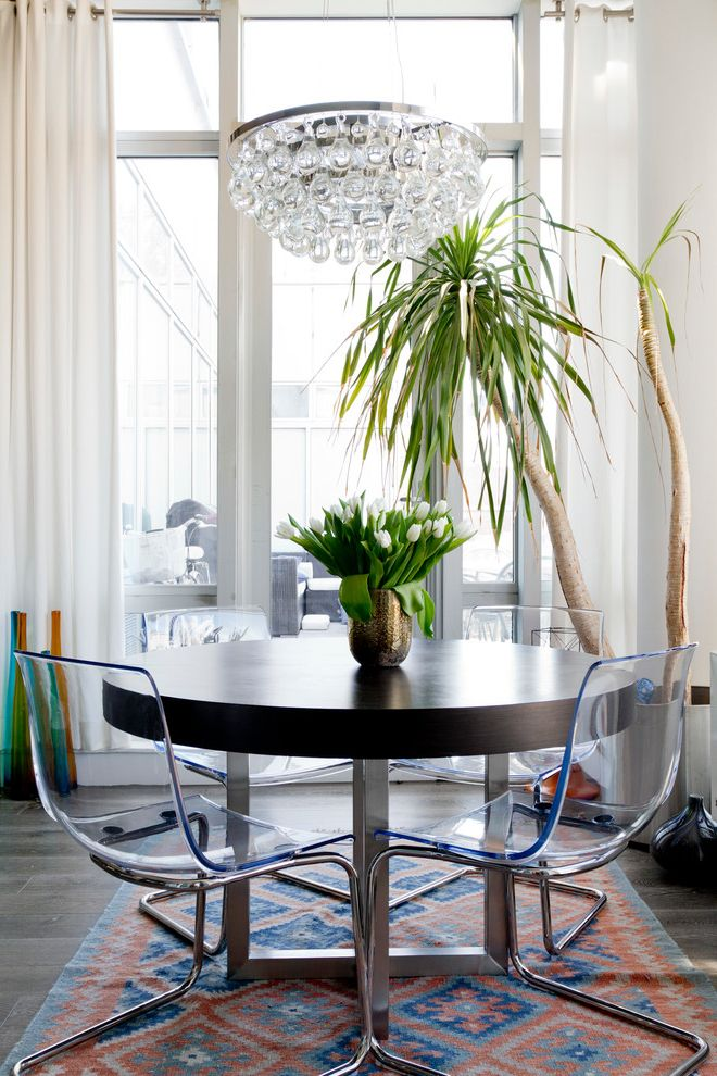 See Through Chairs with Eclectic Dining Room  and Chandelier Clear Chairs Kilim Rug Round Dining Table White Curtains