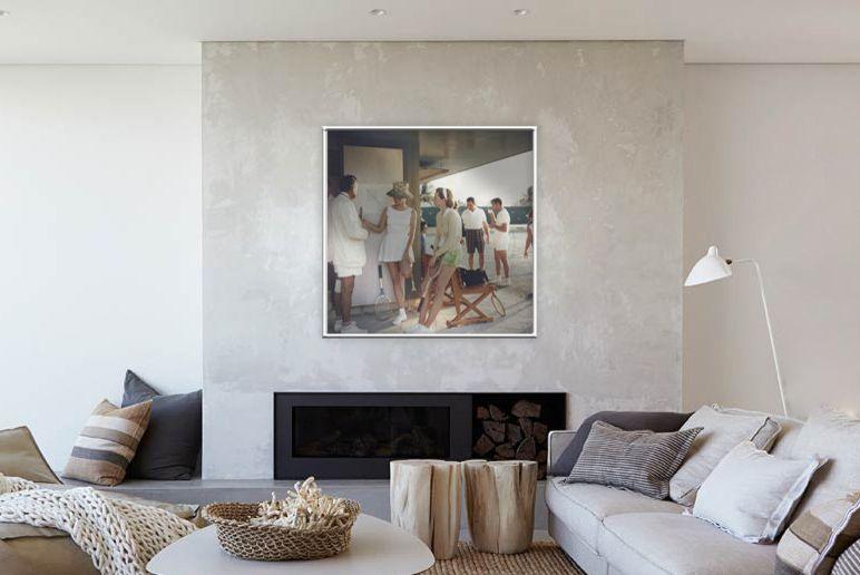 Slim Aarons Prints    Spaces Also 1950s 1960s 1970s Artwork Prints Bahamas Custom Framing Fireplace Grey Sofa Living Room Neutral Tones Prints Slim Aarons Tennis