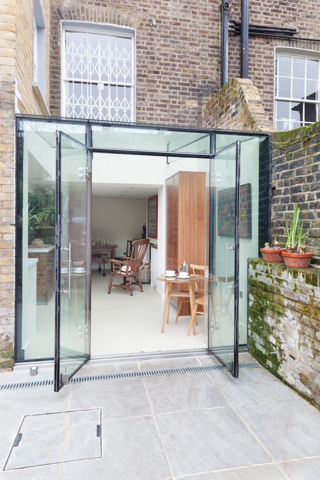 Smart Glass Seattle with Contemporary Exterior Also Brick Ledge Brick Wall Conservatory Courtyard Dining Chairs Glass Ceiling Glass House Extension Glass Patio Doors Glass Table Top Glass Wall Row House Tile Patio Urban White Flooring