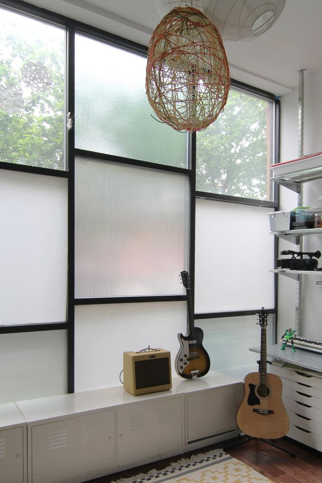 Smart Glass Seattle with Modern Family Room Also Accoustic Adjustable Shelving Amplifier Electric Entry Facade Flat Weave Rug Frosted Glass Glass Guitar Lockers Paper Lantern Storage Storefront String Lantern Town House White Window Panels Wood Floor