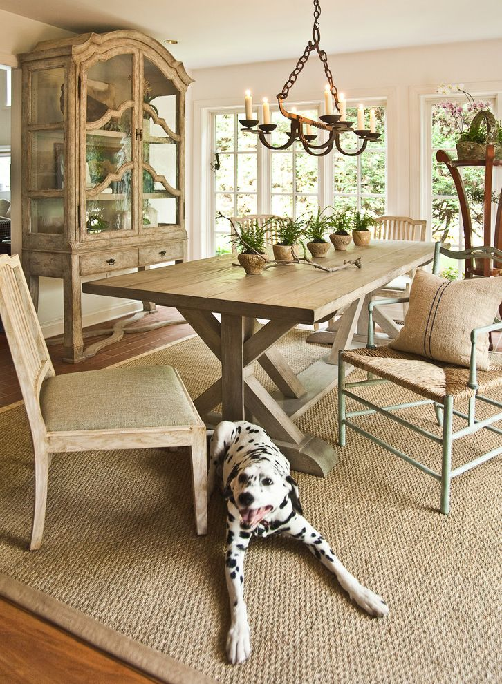 Soft Natural Fiber Rugs   Traditional Dining Room  and Area Rug Glass China Cabinet Light Dining Wood Chairs Light Wood Table Mismatched Dining Chairs Neutral Colors Potted Plants Rustic Chandelier Sisal Rug White Trim White Walls