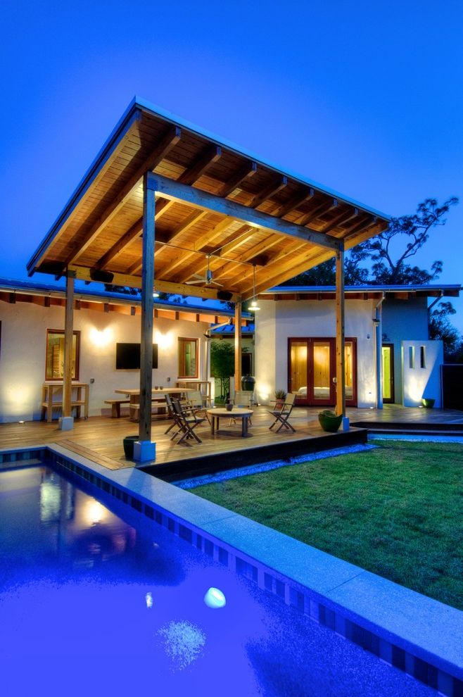 Stand Alone Patio Cover   Modern Pool  and Covered Patio Gravel Landscape Lawn Lighting Outdoor Seating Pool Rafter Tails Stucco Tropical Plants Wood Deck