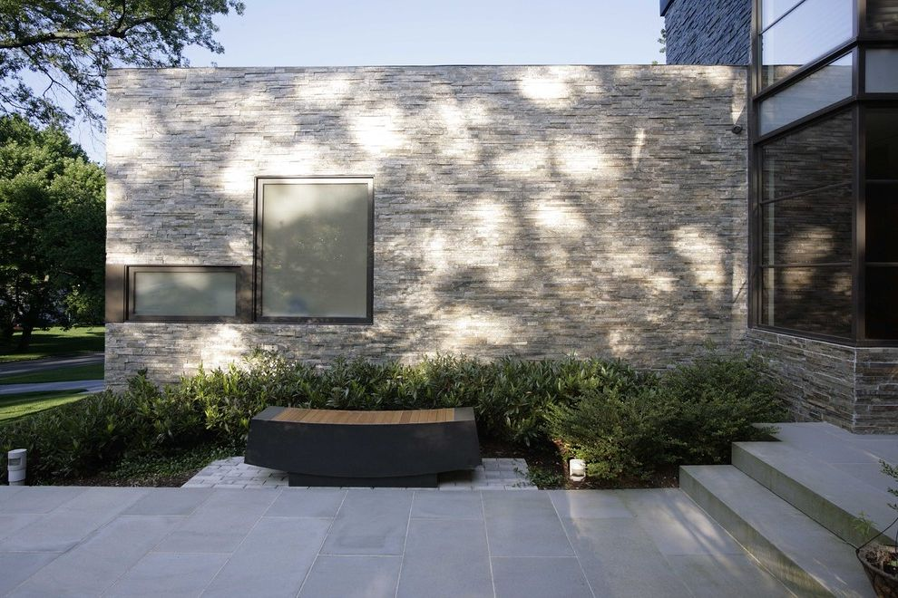 Stone Benches for Sale with Modern Exterior Also Corner Windows Entrance Entry Entry Bench Flat Roof Mass Plantings Neutral Colors Path Pavers Planter Roof Line Stacked Stone Stone Facade Stone Wall Walkway