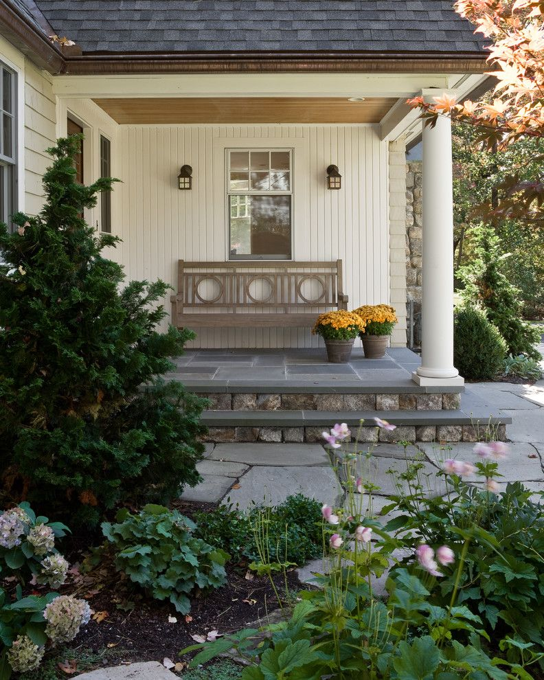Stone Benches for Sale with Traditional Porch Also Beadboard Ceiling Bluestone Cap with Fieldstone Risers Columns Covered Entry Custom Light Fixture Shingle Roof Shingle Siding Stone Steps Wooden Bench