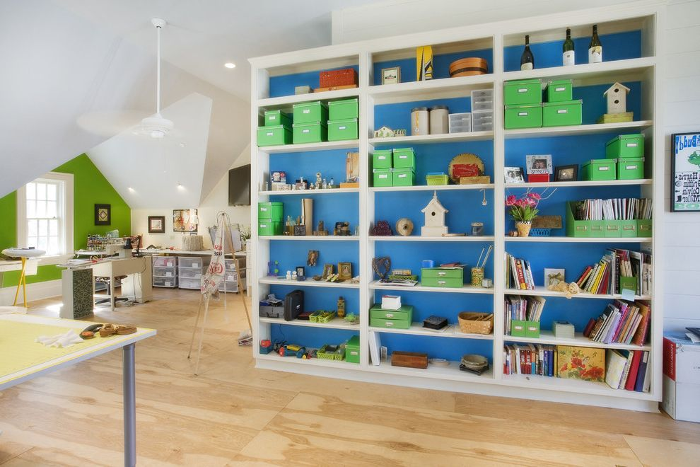 Storage Units Dalton Ga with Eclectic Kids  and Accent Wall Attic Blue Walls Built in Shelves Built in Storage Ceiling Lighting Craft Room Green Accent Loft Magazine Storage Playroom Recessed Lighting Sloped Ceiling Vaulted Ceiling Wood Flooring