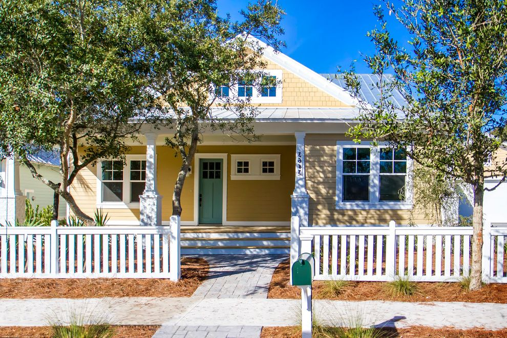 The Porch Key West   Craftsman Exterior  and Clapboard Green Door Square Windows White Fence White Trim Yellow and White Yellow Shingles