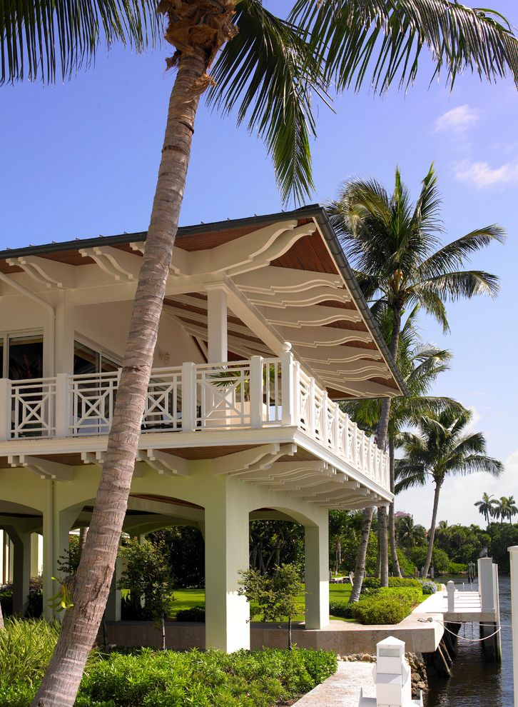 The Porch Key West   Tropical Exterior  and Archway Boat Dock Boathouse Palm Tree View Water View Waterfront White Beams White Exterior White Rafters White Railing White Siding Wood Roof Overhang