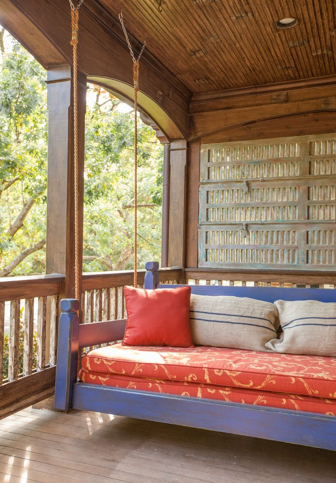 The Porch Key West with Rustic Porch Also Beadboard Blue Swing Orange Cushions Outdoor Cushions Outdoor Furniture Painted Shutters Porch Swing Recessed Lighting Red Cushions Rope Second Floor Porch Shutters Wood Ceiling Wood Railing Wood Screen