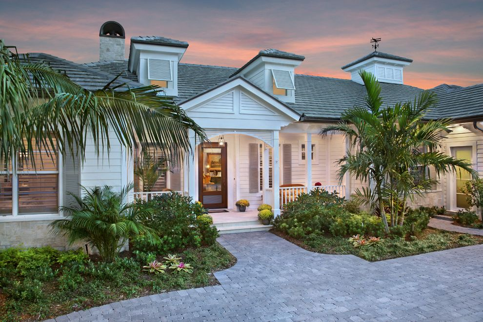 The Porch Key West with Traditional Exterior Also Awning Windows Brick Paving Cupola Dormer Windows Driveway Entrance Entry Front Door Palm Trees Planters Tropical Weathervane Window Shutters Wood Siding
