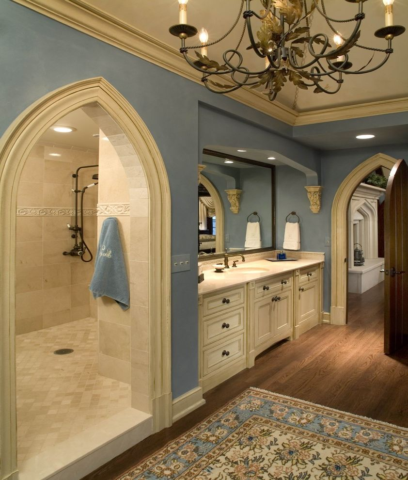 Tile Shop Coon Rapids with Traditional Bathroom Also Arch Doorway Area Rug Baseboards Blue Walls Ceiling Lighting Chandelier Corbels Crown Molding Recessed Lighting Walk in Shower Wet Room White Wood Wood Flooring Wood Trim
