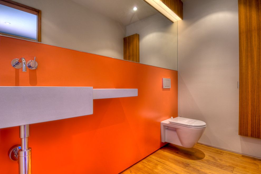 Toto Clayton Toilet with Modern Bathroom  and Accent Wall Bathroom Mirror Floating Toilet Minimal Orange Wall Wall Mount Faucet Wall Mount Sink Wall Mount Toilet Wood Flooring