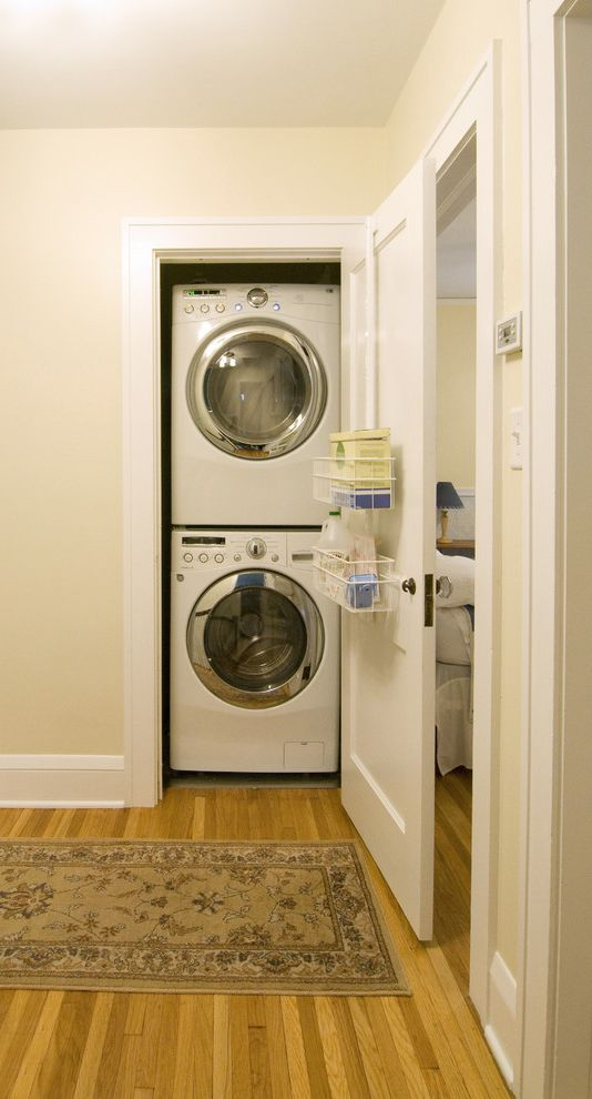 Washer Dryer Stacked Unit   Contemporary Laundry Room Also Baseboards Closet Laundry Room Front Loading Washer and Dryer Stackable Washer and Dryer Stacked Washer and Dryer White Wood Wood Flooring Wood Molding