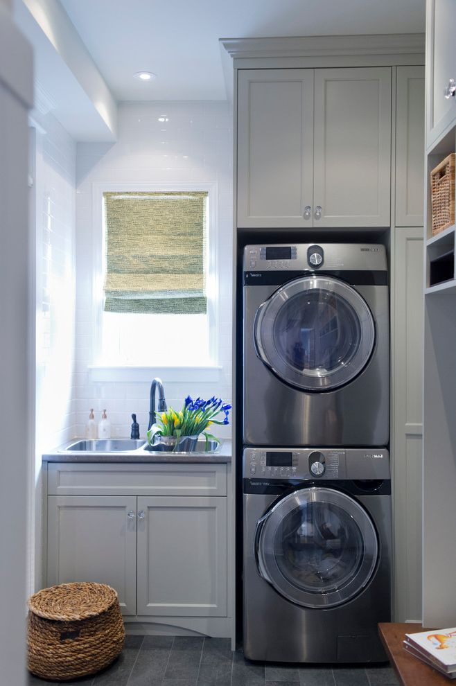 Washer Dryer Stacked Unit   Transitional Laundry Room Also Double Sink Gray Cabinets Gray Drawers Laundry Room Sink Roman Shade Shaker Style Stacked Washer and Dryer Stacked Washer Dryer Tile Floor White Subway Tile White Tile Backsplash Wicker Basket
