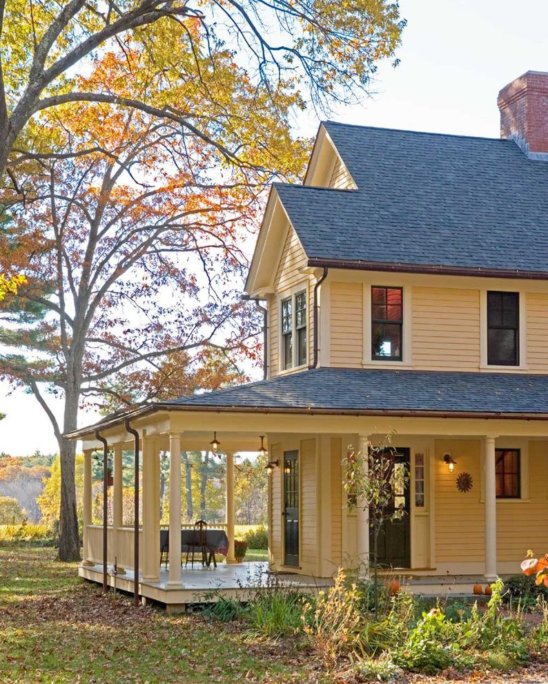 What Are Architectural Shingles with Farmhouse Porch  and Architects Barn Brick Chimney Brick Walkway Column Farmhouse Green Porch Pumpkins Sustainable Veranda Wraparound Porch Yellow House Yellow Siding